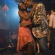 African couple dancing at nightclub — Stock Photo
