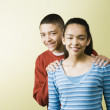 Mixed Race boy with hands on friend's shoulders — Stock Photo