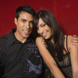 Young multi-ethnic couple hugging — Stock Photo