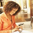 African American woman paying effects — Stock Photo