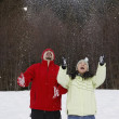Mixed Race couple playing with snow — Stock Photo