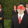 Multi-ethnic businesspeople blindfolded — Stock fotografie