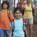 Hispanic family hiking in woods — Stock Photo #23308992
