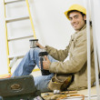 Mixed Race male construction worker drinking coffee — Stock Photo