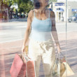 Hispanic woman window shopping — Stok fotoğraf