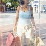 Hispanic woman window shopping — Stock Photo