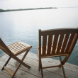 Empty deck chairs on dock — Stock Photo #23309166