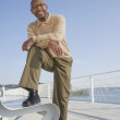 African American man with foot on bench — Stock Photo #23309196
