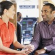 Multi-ethnic couple on airplane — Stock Photo
