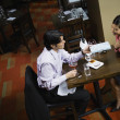 Asian couple at restaurant — Stock Photo
