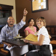 Stock Photo: Multi-ethnic friends at restaurant
