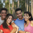 Two young couples hugging — Stock Photo