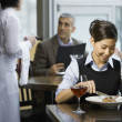 Asian woman eating at restaurant — Stockfoto