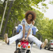 African American couple riding motor scooter — Foto Stock
