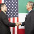 Hispanic businessmen shaking hands — Stock Photo
