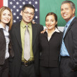 Group of Hispanic businesspeople hugging — Stock Photo