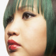 Close up of Asian woman with lip piercing — Stock Photo