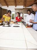 Multi-ethnic couples preparing food — Stock Photo