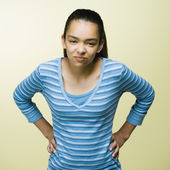 Mixed Race teenage girl with hands on hips — Stock Photo
