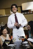 Asian male server taking order — Stock Photo
