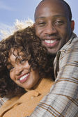 Close up of African American couple hugging — Stock Photo