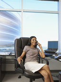 Indian businesswoman talking on telephone — Stock Photo
