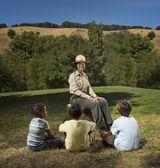Multi-ethnic children listening to Park Ranger — Stock Photo