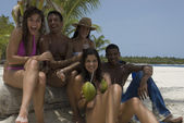 Multi-ethnic friends at beach — Stock Photo
