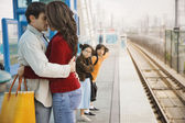 Hispanic couple hugging at train station — Stock Photo