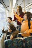 Hispanic family waving from train — Stock Photo