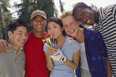 Multi-ethnic friends with trophy — Stock Photo