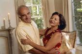 Senior Hispanic couple dancing — Stock Photo