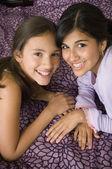 Multi-ethnic girls touching heads — Stock Photo