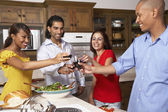 Multi-ethnic couples toasting with wine — Stock Photo