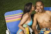 Multi-ethnic couple telling secret — Stock Photo