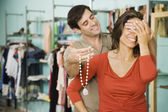 Hispanic man surprising wife with necklace — Stock Photo