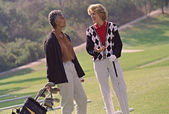 Multi-ethnic senior women on golf course — Stock Photo
