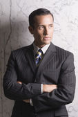 Hispanic businessman with arms crossed — Stock Photo