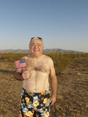 Senior Mixed Race man wearing bathing suit in desert — Stock Photo