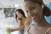 African woman wearing earbuds — Stock Photo