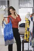 Hispanic woman shopping in clothing store — Stock Photo