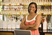 African American female sales clerk at perfume store — Stock Photo
