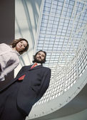 Low angle view of Hispanic businesspeople — Stock Photo