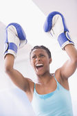 African American woman wearing boxing gloves — Stock Photo