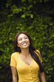 Asian woman laughing outdoors — Stock Photo