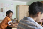 Multi-ethnic boys in classroom — Stock Photo