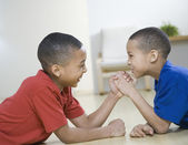 African American brothers arm wrestling — Stock Photo