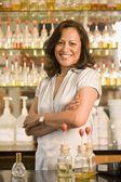 Hispanic female sales clerk at perfume store — Stock Photo