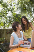 Hispanic mother and daughter shopping online — Stock Photo