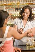 Hispanic female sales clerk helping customer — Stock Photo